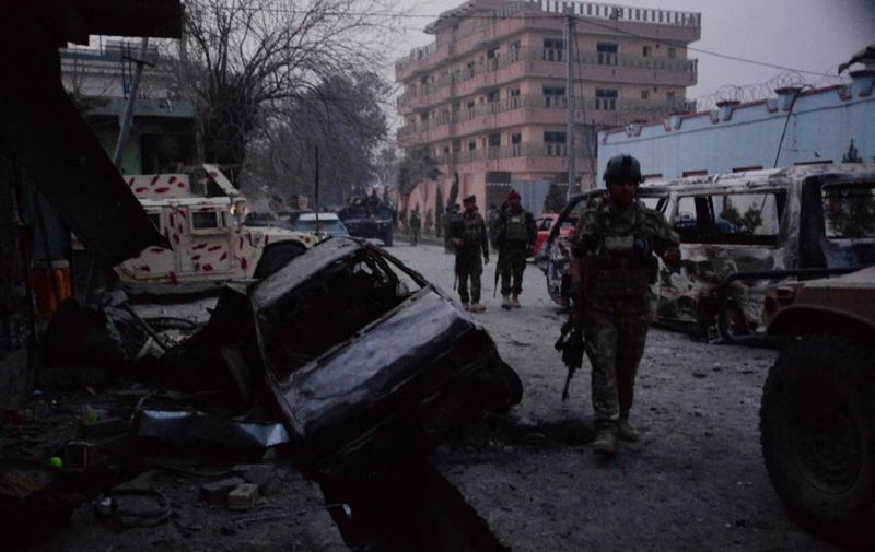 Afghan security forces inspect the site of attack on British charity Save the Children office in Jalalabad on January 24, 2018. Save the Children suspended  operations across Afghanistan on WJanuary 24 as Islamic State militants terrorised staff trapped inside one of its offices in an hours-long attack, the latest assault on a foreign charity. Gunmen blasted their way into the British aid group's compound in the eastern city of Jalalabad, killing at least three people and wounding 24. / AFP PHOTO / Noorullah SHIRZADA