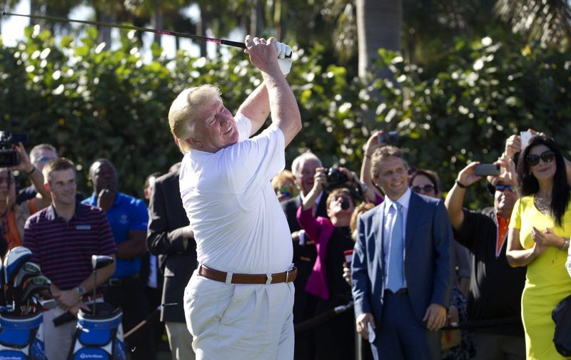 Donald Trump shows off his updated golf course by hitting a ceremonial tee shot off the first tee at Trump National Doral, Feb. 6, 2014, in Doral, Fla. Doral City Council members will discuss a proposed resolution Tuesday to have Trump's golf resort reassessed. (David Walters/Miami Herald/TNS)