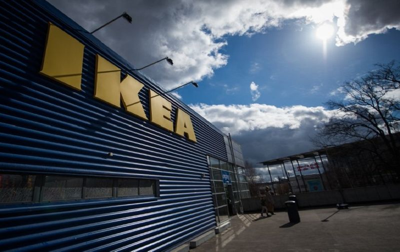 The logo of IKEA is pictured outside Europe's biggest Ikea store in Kungens Kurva, south-west of Stockholm on March 30, 2016.  Ikea founder Ingvar Kamprad, who built a global business empire with revolutionary flat-pack furniture and dallied with Nazism in his youth, turned 90 today. / AFP PHOTO / JONATHAN NACKSTRAND