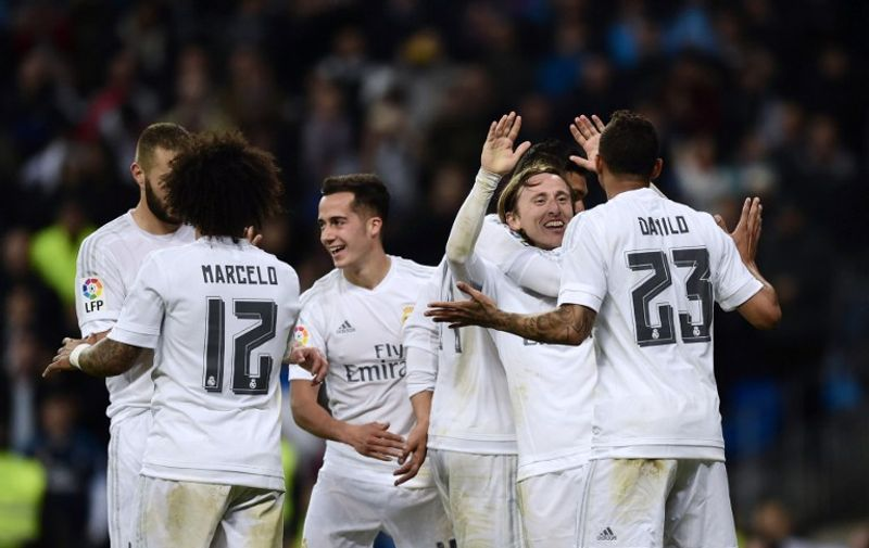 Real Madrid's Croatian midfielder Luka Modric (2nd R) celebrates a goal during the Spanish league football match Real Madrid vs Villarreal at the Santiago Bernabeu stadium in Madrid on April 20, 2016. / AFP PHOTO / PIERRE-PHILIPPE MARCOU