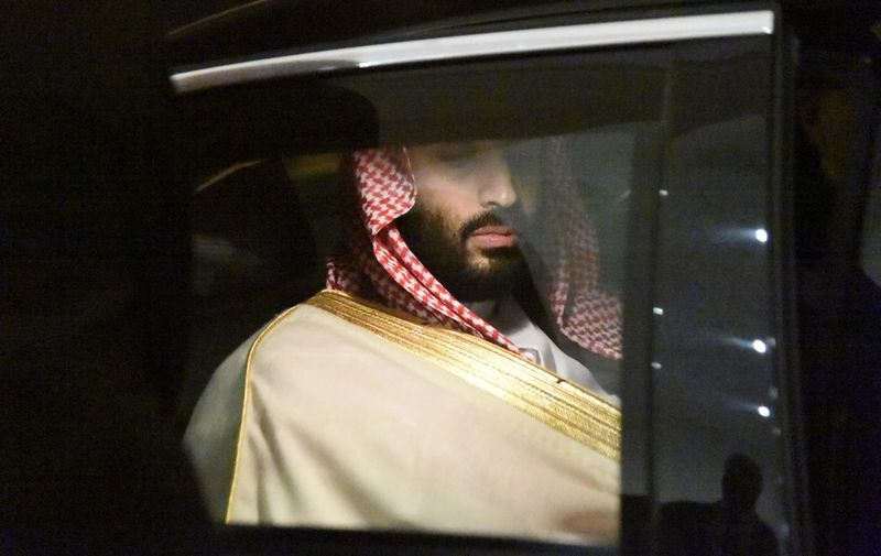 Saudi Crown Prince Mohammed bin Salman is driven to a meeting with Algerian Prime Minister upon the former's arrival at Algiers on December 2, 2018. (Photo by RYAD KRAMDI / AFP)