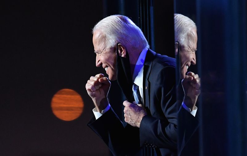 US President-elect Joe Biden gestures to the crowd after he delivered remarks in Wilmington, Delaware, on November 7, 2020. Democrat Joe Biden was declared winner of the US presidency November 7, defeating Donald Trump and ending an era that convulsed American politics, shocked the world and left the United States more divided than at any time in decades.,Image: 567958921, License: Rights-managed, Restrictions: , Model Release: no