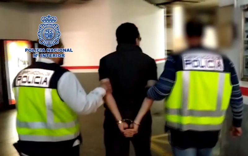 """This image grab taken from a video released on February 12, 2020 by the Spanish Police shows Emilio Lozoya, former chief executive of Mexico's state oil company PEMEX, surrounded by Spanish policemen after his arrest in Malaga. - Emilio Lozoya, PEMEX chief from 2012-18, is accused of accepting millions of dollars in bribes from scandal-tainted Brazilian construction giant Odebrecht. (Photo by - / Spanish Police / AFP) / RESTRICTED TO EDITORIAL USE - MANDATORY CREDIT """"AFP PHOTO /HANDOUT/SPANISH POLICE"""" - NO MARKETING - NO ADVERTISING CAMPAIGNS - DISTRIBUTED AS A SERVICE TO CLIENTS"""