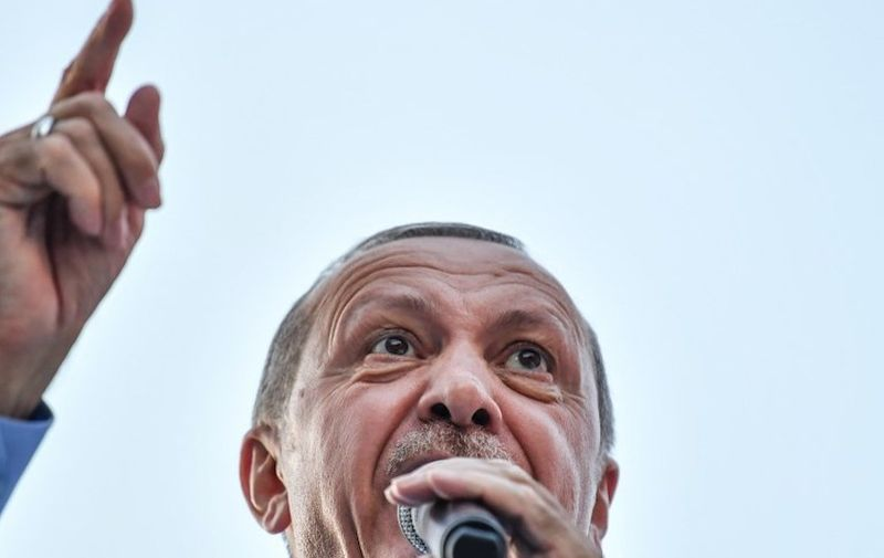 President of Turkey and the leader of the Justice and Development Party (AK Party) Recep Tayyip Erdogan speaks during a rally at the Gaziosmanpasa district of Istanbul, on June 22, 2018.  Turkey will go to the polls in parliamentary and presidential elections on June 24.  / AFP PHOTO / BULENT KILIC