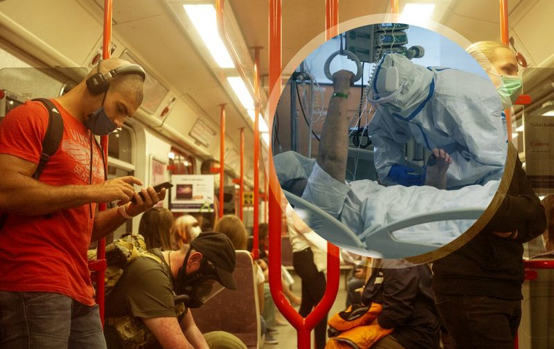 A man wearing gas mask sits on a metro train as other passengers wear faces masks, in Prague, on September 22, 2020. - According to health ministry data, the Czech Republic registered a record high of 3,130 coronavirus cases on September 17, 2020, almost matching the total for the whole of March 2020. (Photo by Michal Cizek / AFP)