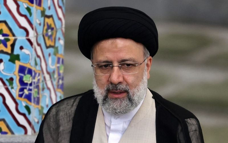 Iranian ultraconservative cleric and presidential candidate Ebrahim Raisi gives a news conference after voting in the presidential election, at a polling station in the capital Tehran, on June 18, 2021. - Raisi on June 19 declared the winner of a presidential election, a widely anticipated result after many political heavyweights were barred from running. (Photo by ATTA KENARE / AFP)