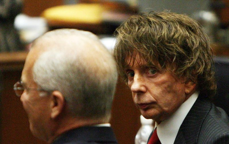 "(FILES) In this file photo music producer Phil Spector(R) is seen with his attorney Roger Rosen during his murder trial at the Los Angeles Superior Court in Los Angeles on September 18, 2007. - Phil Spector, who revolutionized 1960s pop music but ended up in prison for murder, has died, authorities said on January 17, 2021. Spector was pronounced dead on Saturday and his ""official cause of death will be determined by the medical examiner,"" according to a statement from the California Department of Corrections and Rehabilitation. (Photo by Gabriel BOUYS / POOL / AFP)"