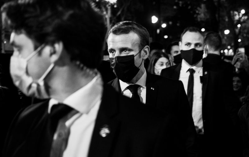 At the end of the ceremony for Samuel Paty at the Sorbonne, Emmanuel Macron walks up the Boulevard Saint Germain and talks with a few people who call out to him. Paris, 2021-10-20. Photograph by Olivier Marchesi Hans Lucas. A l issue de la ceremonie pour Samuel Paty a la Sorbonne, Emmanuel Macron remonte a pied le boulevard Saint Germain et discute avec quelques personnes qui l'interpellent. Paris, 2021-10-20. Photographie par Olivier Marchesi Hans Lucas.,Image: 565203516, License: Rights-managed, Restrictions: , Model Release: no