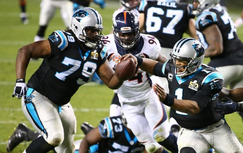 SANTA CLARA, CA - FEBRUARY 07: Cam Newton #1 of the Carolina Panthers scrambles with the ball against the Denver Broncos in the fourth quarter during Super Bowl 50 at Levi's Stadium on February 7, 2016 in Santa Clara, California.   Maddie Meyer/Getty Images/AFP