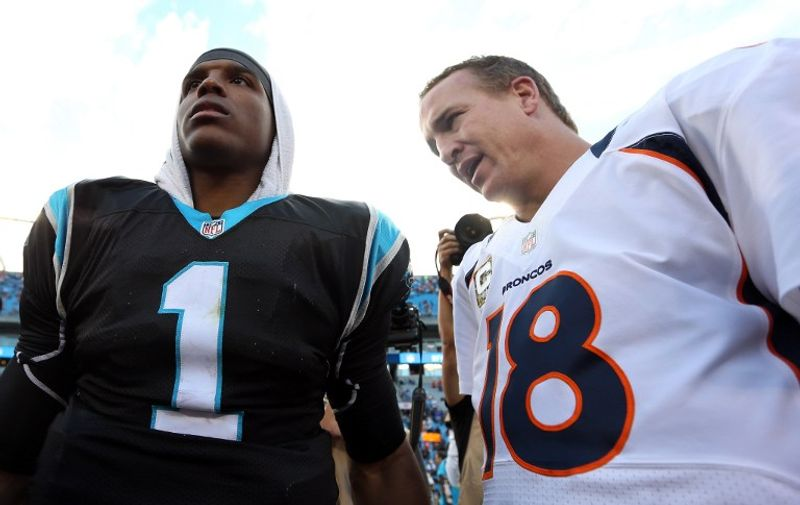 CHARLOTTE, NC - NOVEMBER 11: Cam Newton #1 of the Carolina Panthers talks to Peyton Manning #18 of the Denver Broncos after their game at Bank of America Stadium on November 11, 2012 in Charlotte, North Carolina.   Streeter Lecka/Getty Images/AFP