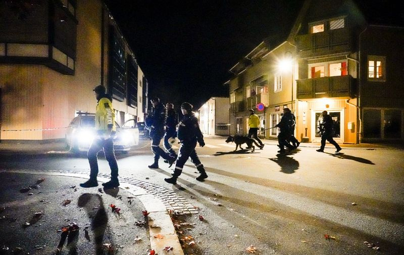 """Police officers cordon off the scene where they are investigating in Kongsberg, Norway after a man armed with bow killed several people before he wasarrested by police on October 13, 2021. - A man armed with a bow and arrows killed several people and wounded others in the southeastern town of Kongsberg in Norway on October 13, 2021, police said, adding they had arrested the suspect. """"We can unfortunately confirm that there are several injured and also unfortunately several killed in this episode,"""" local police official Oyvind Aas told a news conference. """"The man who committed this act has been arrested by the police and, according to our information, there is only one person involved."""" (Photo by Håkon Mosvold Larsen / NTB / AFP) / Norway OUT"""