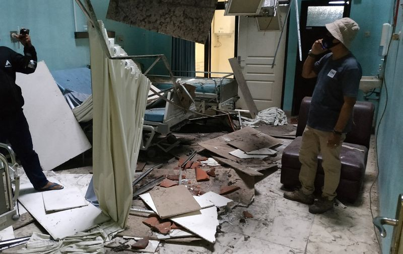 Damage to a ward is seen at the Ngudi Waluyo hospital in Blitar, East Java, on April 10, 2021, after a 6.0 magnitude earthquake struck off the coast of Indonesia's Java island. (Photo by AVIAN / AFP)