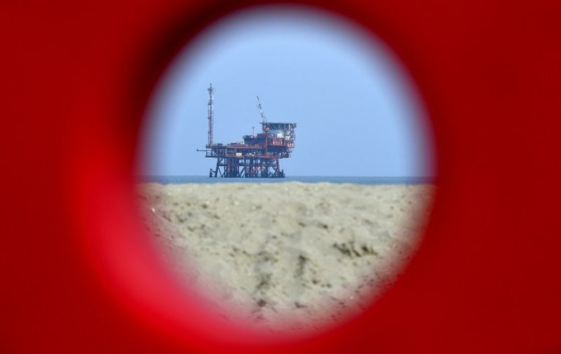 TO GO WITH AFP STORY BY ELLA IDE Italy's ENI gas platform Angelina is seen off Lido di Dante near Ravenna on April 5, 2016.  An offshore platform a stone's throw from Dante's beach on Italy's Adriatic coast has become the focus of a politically charged national referendum on the country's oil and gas drilling concessions. / AFP PHOTO / ALBERTO PIZZOLI