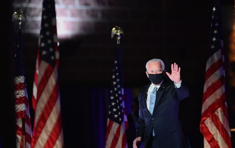 US President-elect Joe Biden waves as he arrives to deliver remarks in Wilmington, Delaware, on November 7, 2020. - Democrat Joe Biden was declared winner of the US presidency November 7, defeating Donald Trump and ending an era that convulsed American politics, shocked the world and left the United States more divided than at any time in decades. (Photo by Angela Weiss / AFP)