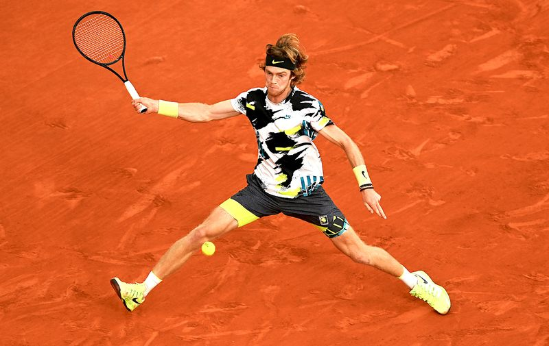 PARIS, FRANCE - OCTOBER 07: Andrey Rublev of Russia plays a forehand during his Men's Singles quarterfinals match against Stefanos Tsitsipas of Greece on day eleven of the 2020 French Open at Roland Garros on October 07, 2020 in Paris, France. (Photo by Shaun Botterill/Getty Images)