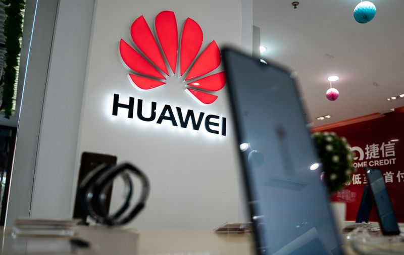A Huawei logo is displayed at a retail store in Beijing on May 20, 2019. - US internet giant Google, whose Android mobile operating system powers most of the world's smartphones, said it was beginning to cut ties with China's Huawei, which Washington considers a national security threat. (Photo by FRED DUFOUR / AFP)