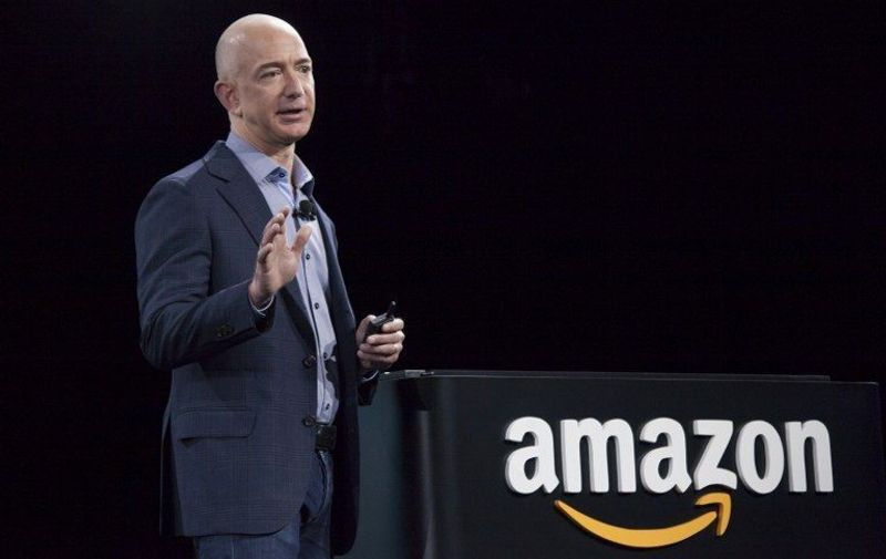 SEATTLE, WA - JUNE 18: Amazon.com founder and CEO Jeff Bezos presents the company's first smartphone, the Fire Phone, on June 18, 2014 in Seattle, Washington. The much-anticipated device is available for pre-order today and is available exclusively with AT&T service.   David Ryder/Getty Images/AFP