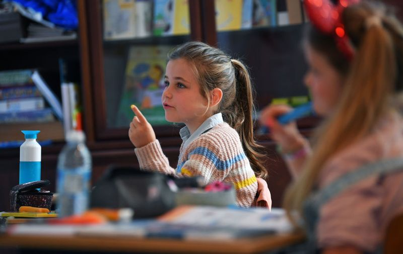 SINT MARTENS LATEM, BELGIUM - MAY 15: Students are returning back to school while the Covid-19 Coronavirus lockdown restrictions are slowly being lifted on May 15, 2020in Sint-Marten-Latem, Belgium. Some children returned to school today as Belgium further eased its two-month coronavirus lockdown after the country started lifting some of the restrictions at the start of May. (Photo by Tim de Waele/Getty Images)