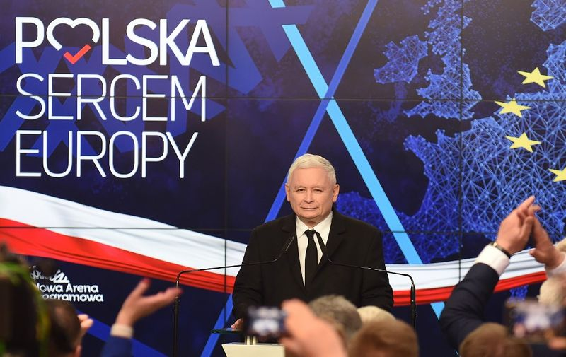 """Jaroslaw Kaczynski, leader of PiS party (Law and Justice) gives a speech after announcing the first results of the European parliament election at the party's headquarters in Warsaw on May 26, 2019. The poster on the wall reads """"Poland heart of Europe"""". (Photo by Janek SKARZYNSKI / AFP)"""