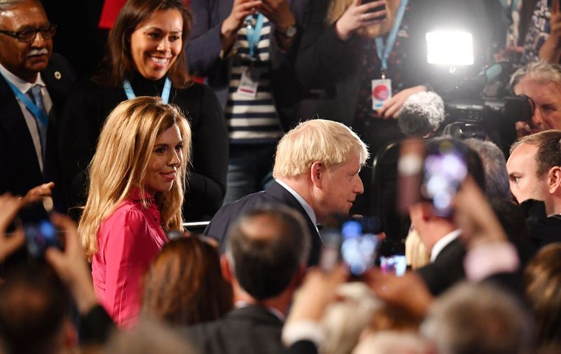 MANCHESTER, ENGLAND - OCTOBER 02: Prime Minister Boris Johnson leaves with his girlfriend Carrie Symonds following his keynote speech on day four of the 2019 Conservative Party Conference at Manchester Central on October 2, 2019 in Manchester, England. The U.K. government prepares to formally submit its finalised Brexit plan to the EU today. The offer replaces the Northern Irish Backstop with border, customs and regulatory checks lasting until 2025. (Photo by Jeff J Mitchell/Getty Images)