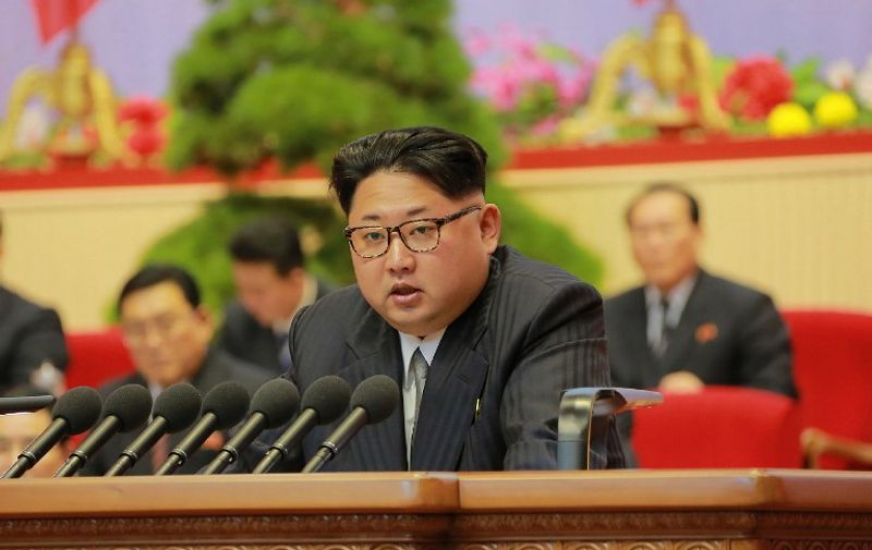 """This photo taken on May 9, 2016 and released on May 10, 2016 by North Korea's official Korean Central News Agency (KCNA) shows North Korean leader Kim Jong-Un making an address to end the 7th Workers Party Congress at the April 25 Palace in Pyongyang. North Korea kicked off a massive parade in the centre of Pyongyang on May 10 to celebrate a just-concluded ruling party congress that was seen as a formal coronation for supreme leader Kim Jong-Un. / AFP PHOTO / KCNA VIA KNS / KCNA / South Korea OUT / REPUBLIC OF KOREA OUT   ---EDITORS NOTE--- RESTRICTED TO EDITORIAL USE - MANDATORY CREDIT """"AFP PHOTO/KCNA VIA KNS"""" - NO MARKETING NO ADVERTISING CAMPAIGNS - DISTRIBUTED AS A SERVICE TO CLIENTS THIS PICTURE WAS MADE AVAILABLE BY A THIRD PARTY. AFP CAN NOT INDEPENDENTLY VERIFY THE AUTHENTICITY, LOCATION, DATE AND CONTENT OF THIS IMAGE. THIS PHOTO IS DISTRIBUTED EXACTLY AS RECEIVED BY AFP.  /"""