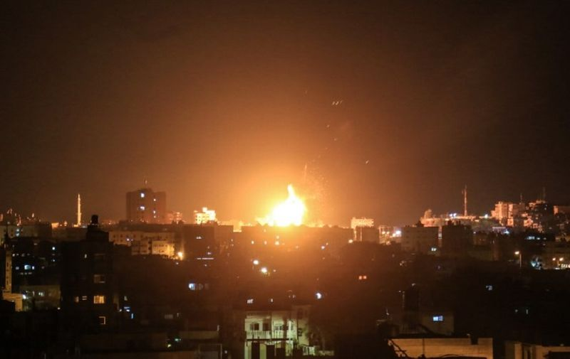 An explosion is seen in northern Gaza City after an airstrike by Israeli forces on June 20, 2018.  Israeli fighter jets hit 25 targets in the Gaza Strip early June 20 in response to rocket fire from the Palestinian territory, the army said.  / AFP PHOTO / ABED ABU RYASH