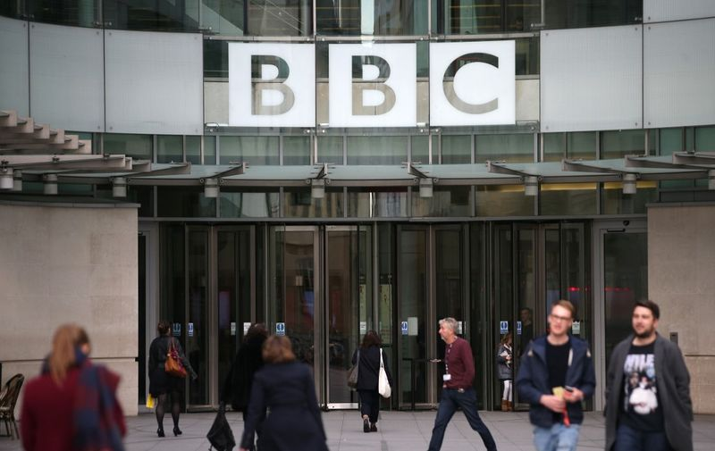 """(FILES) In this file photo taken on October 30, 2017 A general view of the headquarters of the British Broadcasting Corporation (BBC) in London on October 30, 2017. - The BBC will axe 450 jobs in its newsroom as part of plans to adapt """"to changing audience needs"""" and meet its £80 million ($104 million, 95 million euro) savings target, the British broadcaster announced on January 29, 2020. (Photo by Daniel LEAL-OLIVAS / AFP)"""