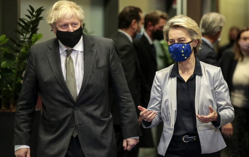 Britain's Prime Minister Boris Johnson (L) is welcomed by European Commission President Ursula von der Leyen (R) in the Berlaymont building at the EU headquarters in Brussels on December 9, 2020, prior to a post-Brexit talks' working dinner. - Britain's Prime Minister arrives in Brussels on December 9, 2020, with hopes for a post-Brexit trade deal hanging on crisis talks with EU chief. Talks are blocked over the issue of fair competition, with Britain refusing to accept a mechanism that would allow the EU to respond swiftly if UK and EU business rules diverge over time and put European firms at a disadvantage. (Photo by Olivier HOSLET / POOL / AFP)