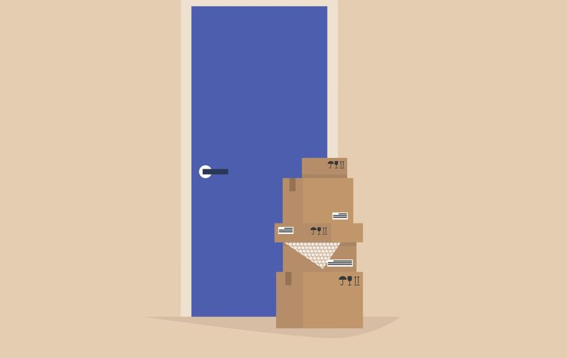 Contact free delivery, packages left next to the entrance, social distancing concept
