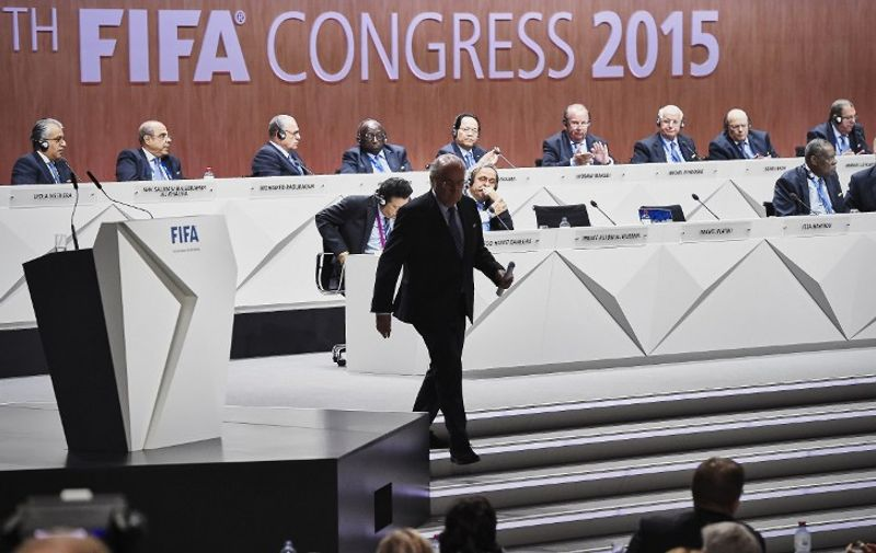 A photo taken on May 29, 2015 shows FIFA President Sepp Blatter leaving the stage during the 65th FIFA Congress in Zurich. Blatter on June 2, 2015 resigned as president of FIFA as a mounting corruption scandal engulfed world football's governing body. The 79-year-old Swiss official, FIFA president for 17 years and only reelected on May 29, said a special congress would be called as soon as possible to elect a successor.  AFP PHOTO / MICHAEL BUHOLZER