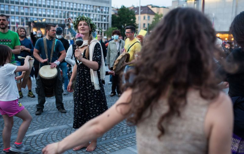 Protesters perform and dance in front of the parliament building during an anti-government protest. Thousands of people on bicycles and on foot again protested against the government, they accused Prime Minister Janez Jansa of using the covid-19 crisis situation for corruption and undemocratic rule. Anti-government protest continues in Ljubljana, Slovenia - 22 May 2020,Image: 521602417, License: Rights-managed, Restrictions: , Model Release: no