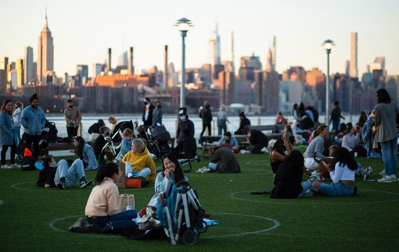 Social distancing circles are seen as people visit Domino Park in Brooklyn as New York City experiences warm temperatures on March 12, 2021. (Photo by Kena Betancur / AFP)