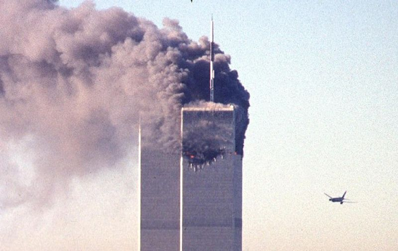 A hijacked commercial plane approaches the World Trade Center shortly before crashing into the landmark skyscraper 11 September 2001 in New York.  AFP PHOTO SETH MCALLISTER
