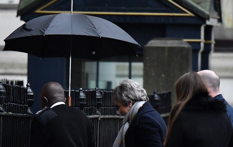 """Britain's Prime Minister Theresa May (C) arrives at the rear of 10 Downing Street in central London on February 4, 2019. - British Prime Minister Theresa May said on February 3 she would be """"armed with a fresh mandate and new ideas"""" when she next meets European Union negotiators over her Brexit deal. (Photo by Ben STANSALL / AFP)"""