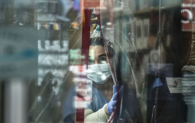 NEW YORK, NY - APRIL 1: A pharmacist works while wearing personal protective equipment in the Elmhurst neighborhood on April 1, 2020 in New York City. With more than 75,000 confirmed cases of COVID-19 and more than 1,000 deaths, New York City has become the epicenter of the outbreak in the United States. (Photo by Stephanie Keith/Getty Images)