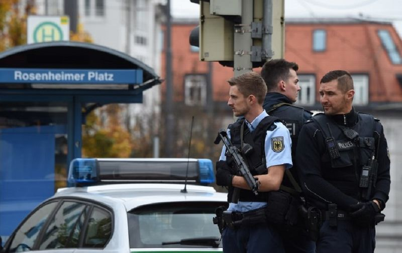 German police officers stand guard near Rosenheimer square after a man attacked passersby on October 21, 2017 in the southern German city of Munich. The man attacked passersby in five places near Rosenheimer Platz in the eastern part of the city centre at around 0630 GMT, inflicting light injuries on four people, a police spokesman told AFP. The perpetrator, described by the police as a man in his forties, wearing grey pants and a running jacket, fled the scene on a black bicycle. / AFP PHOTO / Christof STACHE