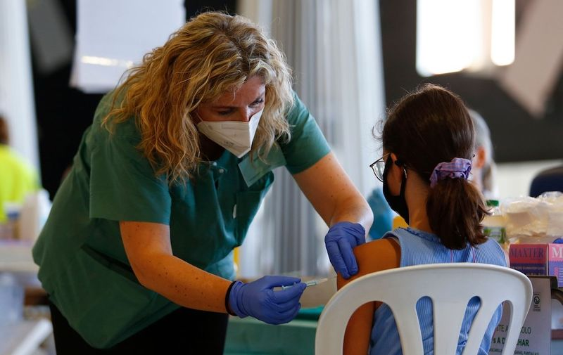 A nurse vaccinates a girl while the COVID-19 vaccination goes on for children and young people in Granada, Spain on September 03, 2021. Children and young people COVID-19 vaccination continues in Andalucia, Spain, Granada - 03 Sep 2021,Image: 630220773, License: Rights-managed, Restrictions: RESTRICTED TO EDITORIAL USE, Model Release: no, Credit line: Profimedia