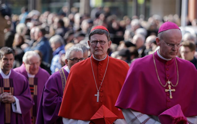The Archbishop of Cologne Cardinal Rainer Maria Woelki (in red) walks among the bishops in the funeral procession of Cardinal Karl Lehmann. The funeral of Cardinal Karl Lehmann was held in the Mainz Cathedral, following a funeral procession from the Augustiner church were he was lying in repose. German President Frank-Walter Steinmeier attended the funeral as representative of the German state. Cardinal Karl Lehmann was the bishop of the Roman Catholic Diocese of Mainz for 33 years until his retirement in 2016. He was also the chairman of the Episcopal Conference of Germany for 21 years until he stepped down from this position in 2008. (Photo by Michael Debets/Pacific Press), Image: 366613005, License: Rights-managed, Restrictions: *** GETTY OUT ***, Model Release: no, Credit line: Profimedia, Barcroft Media