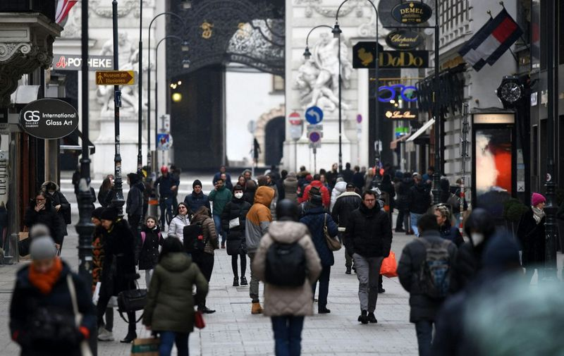 People go shopping in Vienna's Kaerntner Street as Austria reduces its lockdown restrictions  on February 8, 2021 amid the ongoing coronavirus COVID-19 pandemic. (Photo by HELMUT FOHRINGER / APA / AFP) / Austria OUT
