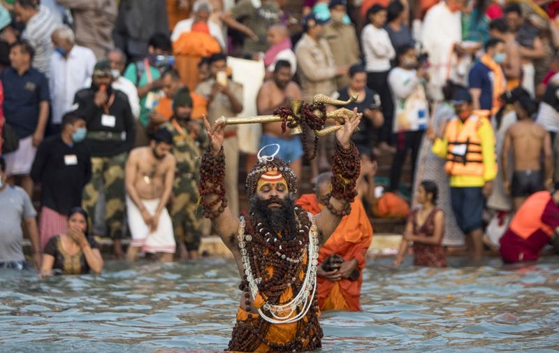 A Sadhu bathes in the Ganges river during the ongoing religious Kumbh Mela festival in Haridwar on April 12, 2021. (Photo by Xavier GALIANA / AFP)