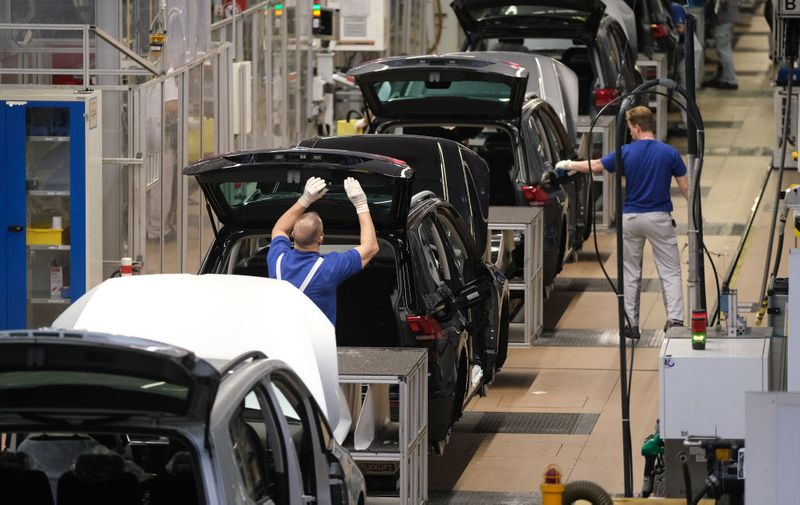BERLIN, GERMANY - MARCH 01: Workers assemble cars on the assembly line for Volkswagen Touareg, Touran and T-Roc models at the Volkswagen factory on March 01, 2019 in Wolfsburg, Germany. Volkswagen is scheduled to hold its annual press conference to announce financial results for last year on March 12 (Photo by Sean Gallup/Getty Images)