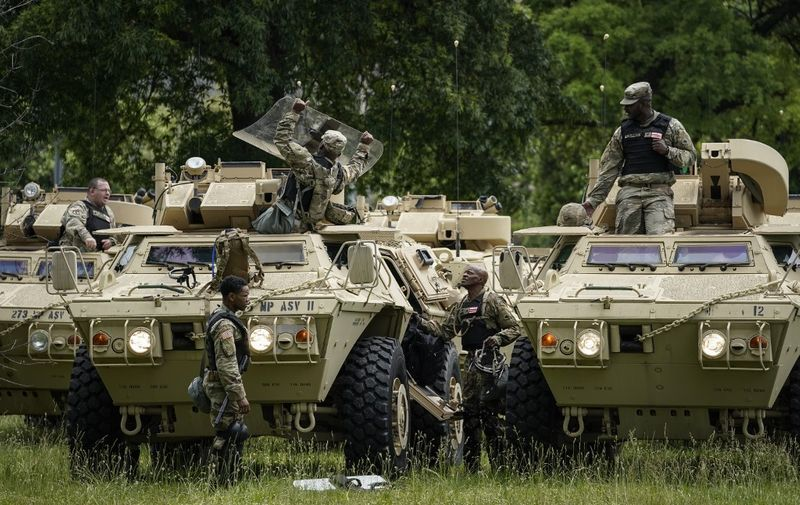 WASHINGTON, DC - JUNE 02: Members of the National Guard Military Police board armored personnel carriers at the Joint Force Headquarters of the D.C. National Guard on June 2, 2020 in Washington, DC. Protests continue to be held in cities throughout the country over the death of George Floyd, a black man who died in police custody in Minneapolis on May 25.   Drew Angerer/Getty Images/AFP
