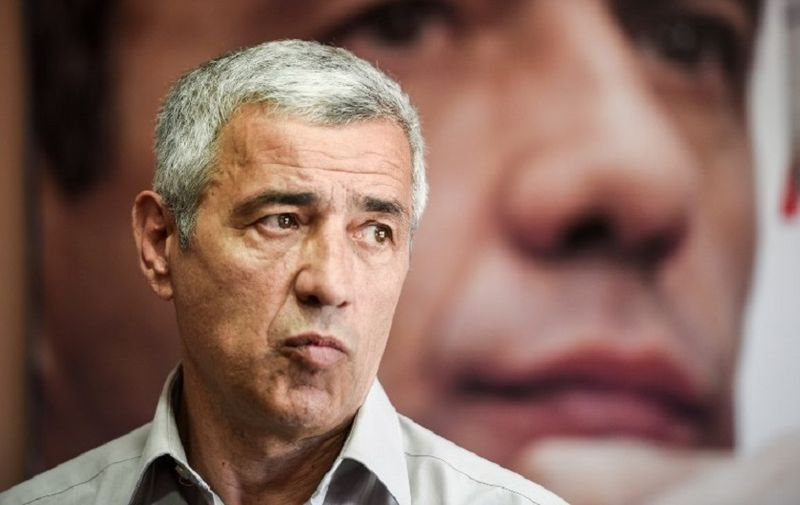 A picture taken on May 5, 2017 shows the leading Kosovo Serb politician Oliver Ivanovic during an interview for the AFP in his office in north Mitrovica.   Ivanovic was killed in a brazen drive-by shooting on January 16, 2018, in the north of Mitrovica. The assassination of Ivanovic - who was facing a retrial on war crimes charges over the 1990s Kosovo conflict - occurred on the very day that Belgrade and Pristina resumed talks on normalising ties after a hiatus of more than a year.  / AFP PHOTO / Armend NIMANI