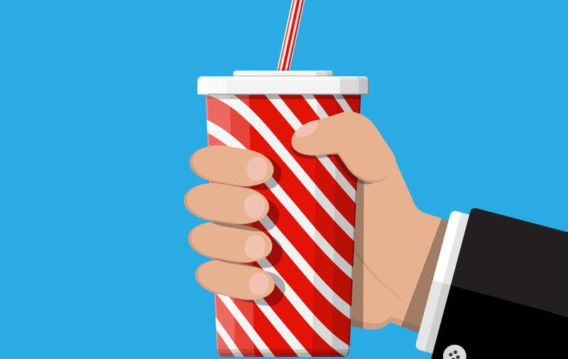 Red striped paper glass with drinking straw in hand. Disposable cup for beverages. Fast food. Vector illustration in flat style (Red striped paper glass with drinking straw in hand. Disposable cup for beverages. Fast food. Vector illustration in flat