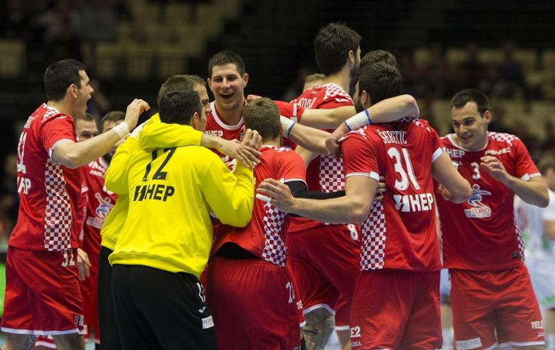 Players from Croatia celebrate after beating Norway in their Men's Handball Olympic Qualification match in Herning, on April 10, 2016.   / AFP PHOTO / Scanpix Denmark / Frank Cilius / Denmark OUT