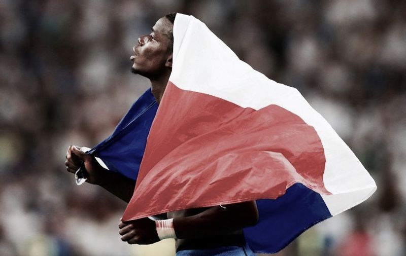Paul Pogba of France with a flag at the end of the game after the UEFA Euro 2016, Semi Final football match between Germany and France on July 7, 2016 at Velodrome stadium in Marseille, France - Photo Kieran McManus / Backpage Images / DPPI