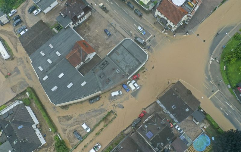 An aerial view taken on on July 14, 2021 shows a flooded intersection in Hagen, western Germany, after heavy rain hit parts of the country, causing widespread flooding. (Photo by INA FASSBENDER / AFP)