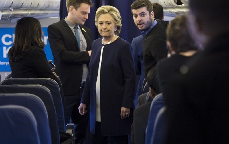 Democratic presidential nominee Hillary Clinton pauses while speaking to staff on her campaign plane at Westchester County Airport November 4, 2016 in White Plains, New York. / AFP PHOTO / Brendan Smialowski