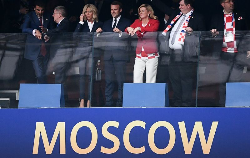 (L to R) Amir of Qatar Sheikh Tamim bin Hamad al-Thani, International Olympic Committee (IOC) President Thomas Bach, French First lady Brigitte Macron, French President Emmanuel Macron, Croatian President Kolinda Grabar-Kitarovic and her husband Jakov Grabar-Kitarovic attend the Russia 2018 World Cup final football match between France and Croatia at the Luzhniki Stadium in Moscow on July 15, 2018. (Photo by Jewel SAMAD / AFP) / RESTRICTED TO EDITORIAL USE - NO MOBILE PUSH ALERTS/DOWNLOADS