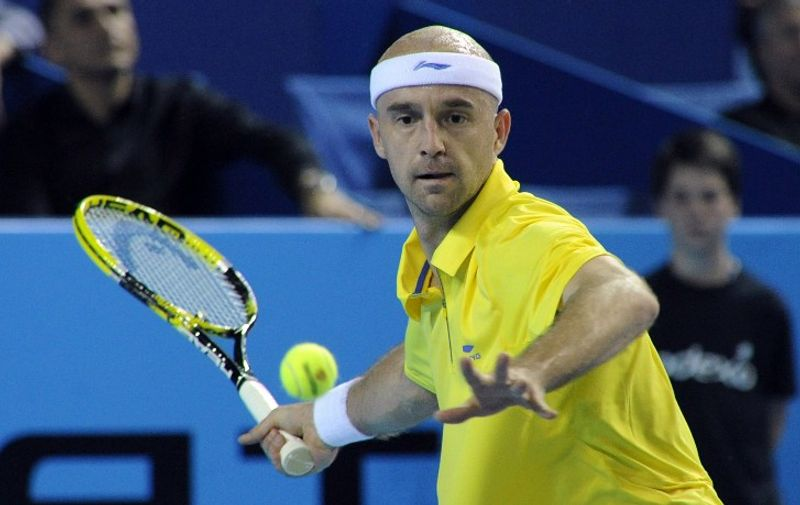 Croatian Ivan Ljubicic hits a return to Serbian Janko Tipsarevic during the ATP Open 13 tennis tournament quarter final on February 24, 2012 in Marseille, southern France. AFP PHOTO / ANNE-CHRISTINE POUJOULAT